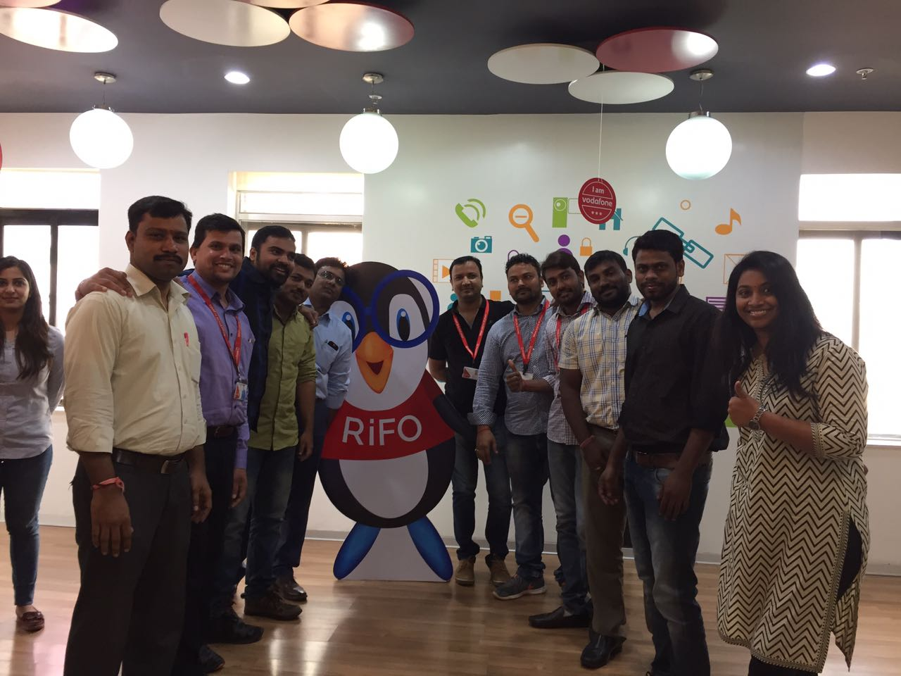 Vodafone employees pose with RiFO