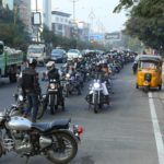 Bikers ride across the busy streets of Hyderabad